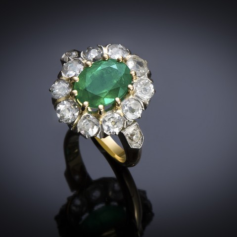 An early 20th century emerald an diamond ring