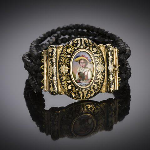 Bracelet XIXe siècle miniature entourée d'émail et jais taillé à facettes
